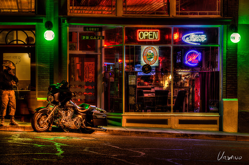 """Horse Envy"" - Even the street seems to be running with rivers of green 'envy' as a cowboy contemplates another man's horse parked outside a saloon. The detail in this photo keeps viewers busy for extended periods of time."